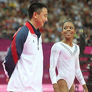 Gabrielle Douglas, USA, with coach Liang Chow in the  Gymnastics Artistic Women's Apparatus, Beam final at North Greenwich Arena during the London 2012 Olympic games London, UK. 7th August 2012. Photo Tim Clayton