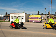 Motorcyclist ride through White Sulphur Springs, Montana,
