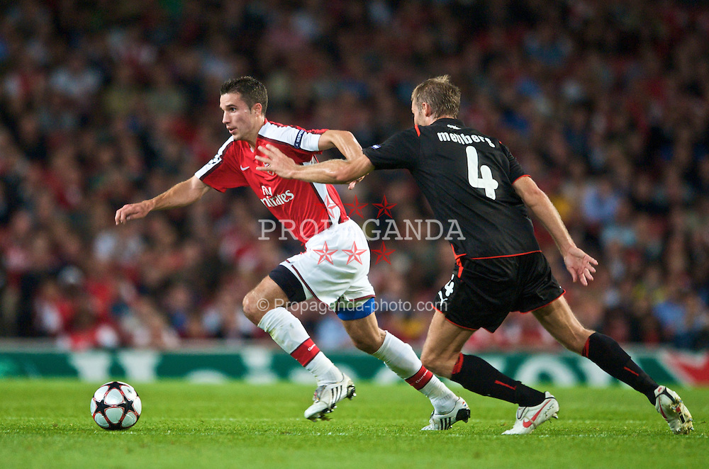 LONDON, ENGLAND - TUESDAY, SEPTEMBER 29th, 2009: Arsenal's Robin Van Persie and Olympiakos' Olof Mellberg during the UEFA Champions League Group H match at the Emirates Stadium. (Photo by Chris Brunskill/Propaganda)