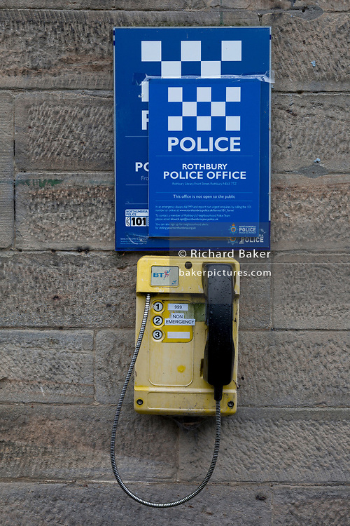 A detail of a Northumberland emergency (and non-emergency) phone, outside a rural police station, on 25th September 2017, in Rothbury, Northumberland, England.