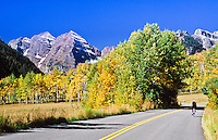 A bicycle rider riding the road to Maroon Bells, Colorado, USA