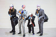 UNITED KINGDOM, London: 23 October 2015 (From left to right) John MacDonald 22, Tom Oliver 20, Cathryn Koenig 23 and Graham Zipfell 24 pose for a picture dressed as the Payday Gang at the 2015 MCM London Comic Con which is being held at London's ExCel Arena. The event will be host to more than 110,000 comic con fans and cosplay enthusiasts over the weekend. Rick Findler / Story Picture Agency