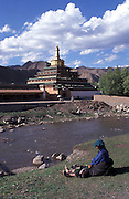 Pilgrim relaxing by Dasha river..LAMBRANG MONASTERY IN XIAHE - CHINA.copyright: Androniki Christodoulou