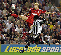 Photo: Paul Thomas.<br /> Liverpool v Newcastle United. The Barclays Premiership. 20/09/2006.<br /> <br /> Goal scorer Dirk Kuyt (L) of Liverpool wins the ball ahead of Celestine Babayaro.