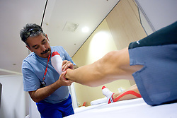 Physiotherapist of Slovenian athletics team Khalid Nasif doing a massage in a Team's Hotel Estrel  during day five of the 12th IAAF World Athletics Championships at the Olympic Stadium on August 19, 2009 in Berlin, Germany. (Photo by Vid Ponikvar / Sportida)