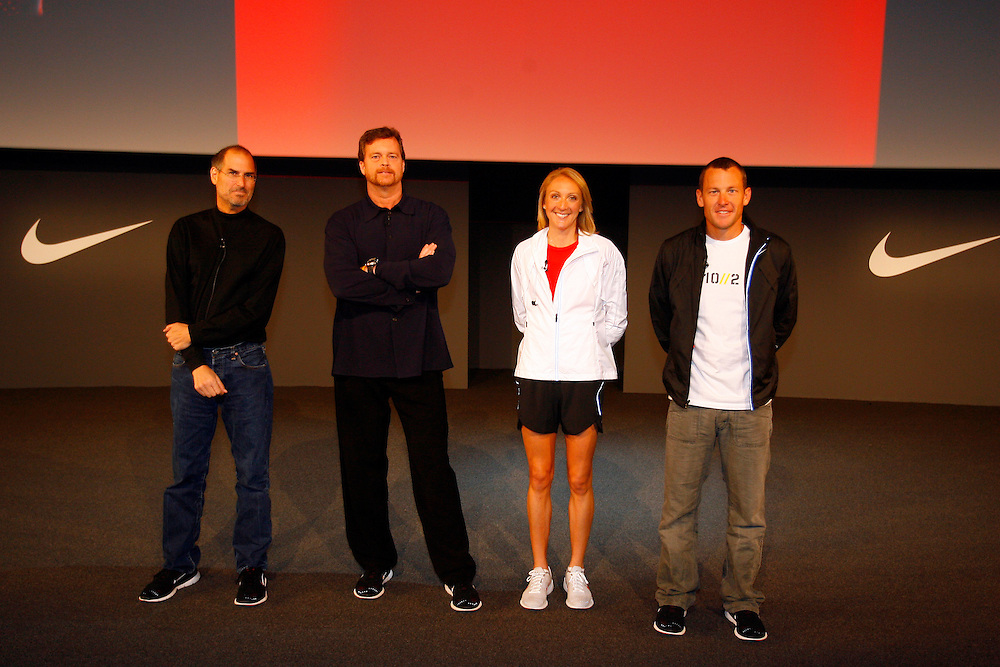 Nike CEO Mark Parker and Apple CEO Steve Jobs introduce the Air Zoom Moire at a press conference in New York City Tuesady May 23, 2006. The Air Zoom Moire is the first footwear designed to communicate with Apple's iPod..