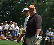 Jun 26, 2006; Gaylord MI; Craig Stadler (front) and Fred Couples (back) walk up to the first green during the ING Par-3 Shootout at Treetops Resort in Gaylord Michigan.