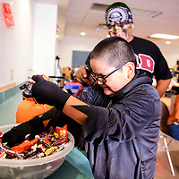Aiden Benally, 8, goes trick or treating at the Octavia Fellin Public Library Children's Branch on Halloween during the Dia de Los Muertos Celebration.