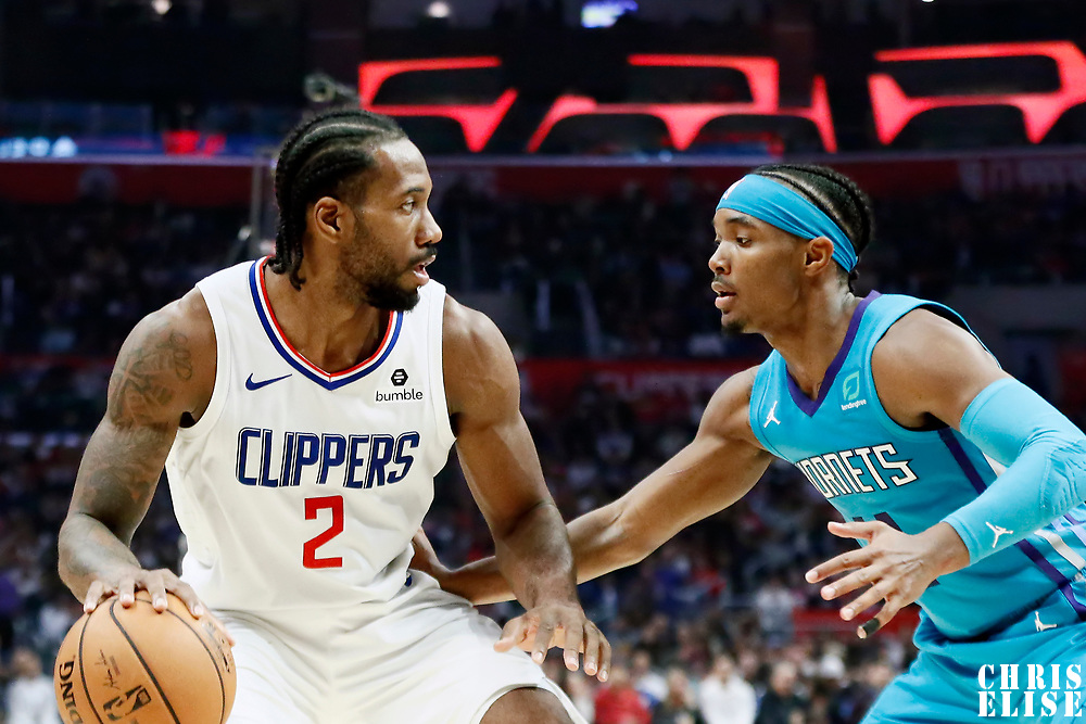 LOS ANGELES, CA - OCT 28: Devonte' Graham (4) of the Charlotte Hornets defends on Kawhi Leonard (2) of the LA Clippers during a game on October 28, 2019 at the Staples Center, in Los Angeles, California.