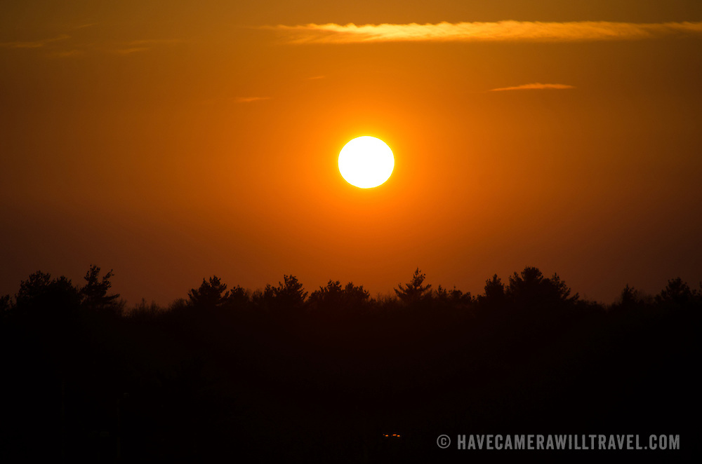 The orange glow of a setting sun.
