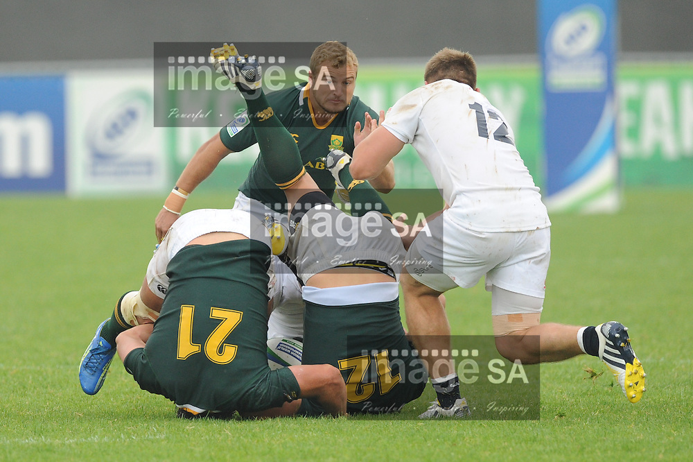 LA ROCHE-SUR-YON, FRANCE - JUNE 09: Dries Swanepoel, Handre Pollard of South Africa and Sam Hill of England during the 2013 IRB Junior World Championship match between South Africa and England at Stade Henri Degranges on June 09, 2013 in La Roche-sur-Yon, France. (Photo by Roger Sedres/Gallo Images)