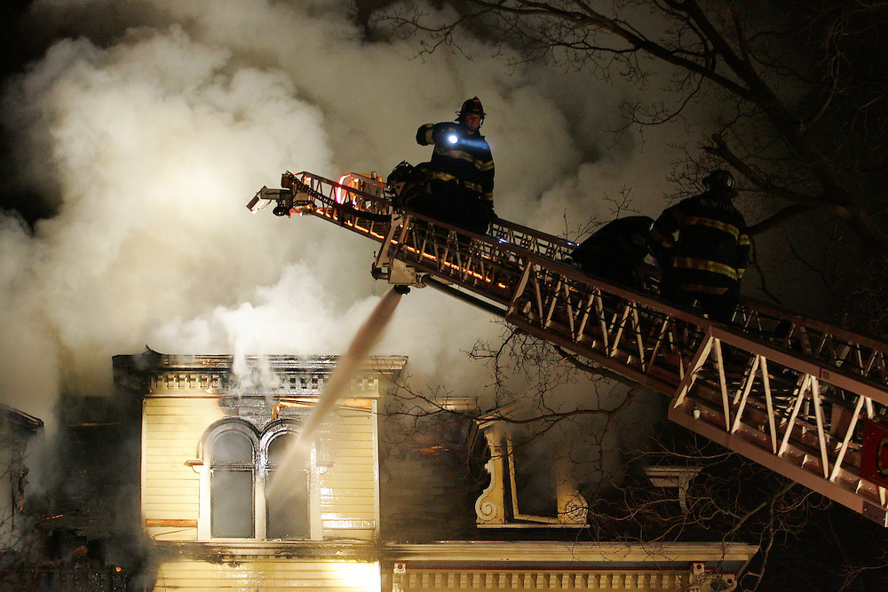 Newton, MA 02/21/2011.Newton firefighters work to extinguish a 4 alarm structure fire at 56 Waverly Ave in Newton early Monday morning.  One occupant was transported to Newton-Wellesley Hospital and another one remained unaccounted for, officials said..Alex Jones / For The Newton TAB