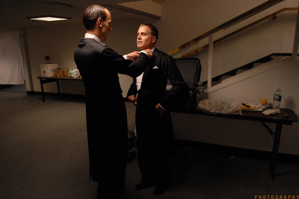 """Same-sex ballroom dancers Soren (umlaut on the """"o""""), left,  and Bradley Stauffer-Kruse, of London, England, get dressed for the men's standard competition at the 5 Boro Dance Challenge on May 5, 2007. ..The locally produced 5 Boro Dance Challenge, New York City's first major same-sex dance competition, was held at the Park Central Hotel in Manhattan from May 4-6, 2007."""