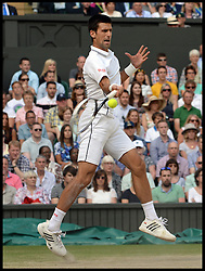 Image licensed to i-Images Picture Agency. 06/07/2014. London, United Kingdom. Novak Djokovic beats Rodger Federer in the Wimbledon Men's Final.  Picture by Andrew Parsons / i-Images