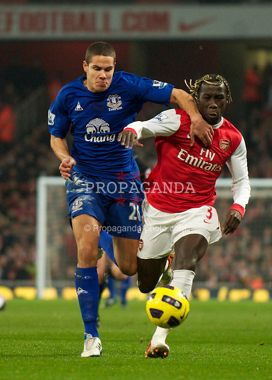 LONDON, ENGLAND - Tuesday, February 1, 2011: Everton's Jack Rodwell and Arsenal's Bacary Sagna during the Premiership match at the Emirates Stadium. (Photo by David Rawcliffe/Propaganda)