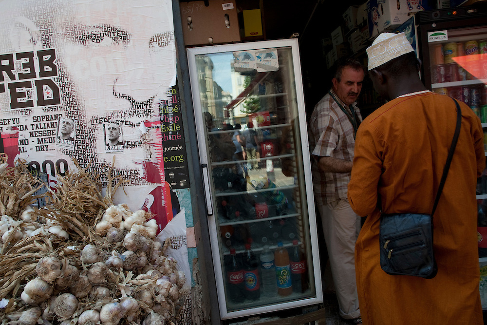 A shop at Rue Longue des Capucins selling fresh vegetables and soda