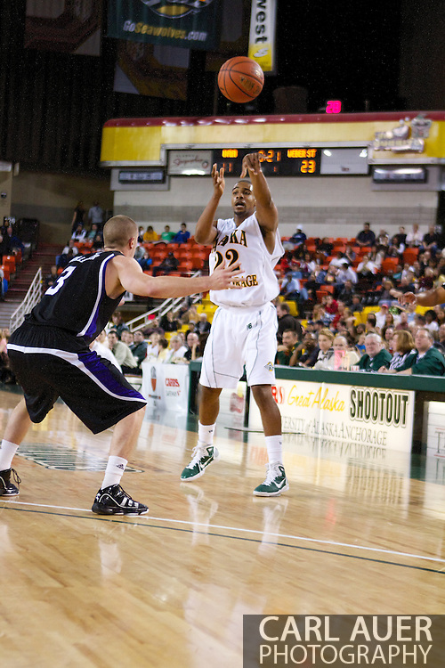 November 25th, 2010:  Anchorage, Alaska - University of Alaska-Anchorage guard Brandon Walker (22) passes to the low post in the Seawolves 54-86 loss to Weber State in the first round of the Great Alaska Shootout.