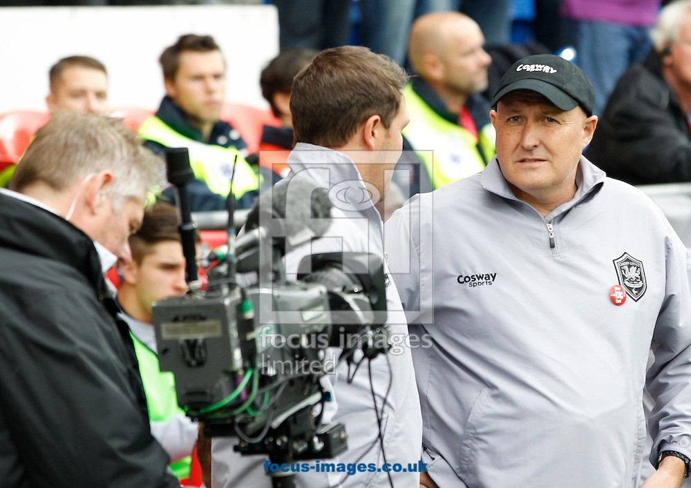 Russell Slade, Manager (R) of Cardiff City during the Sky Bet Championship match at the Cardiff City Stadium, Cardiff<br /> Picture by Mike  Griffiths/Focus Images Ltd +44 7766 223933<br /> 18/10/2014