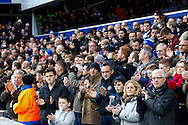 Picture by David Horn/Focus Images Ltd +44 7545 970036<br /> 07/12/2013<br /> Queens Park Rangers Fans celebrate the life of Nelson Mandela with a minute's applause before the Sky Bet Championship match at the Loftus Road Stadium, London.