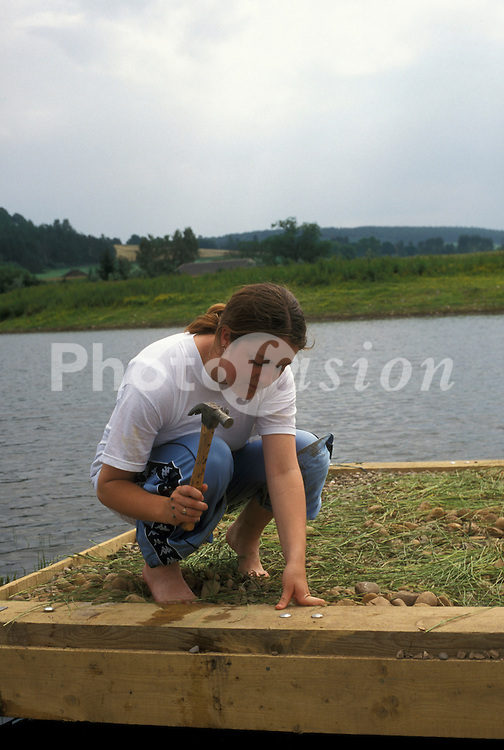 Volunteer building floating platform for nesting birds; Angus Scotland