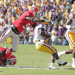 25 October 2008:  Georgia safety Reshad Jones (9) closes in for a tackle on LSU wide receiver Trindon Holliday (8) during the Georgia Bulldogs 52-38 victory over the LSU Tigers at Tiger Stadium in Baton Rouge, LA.