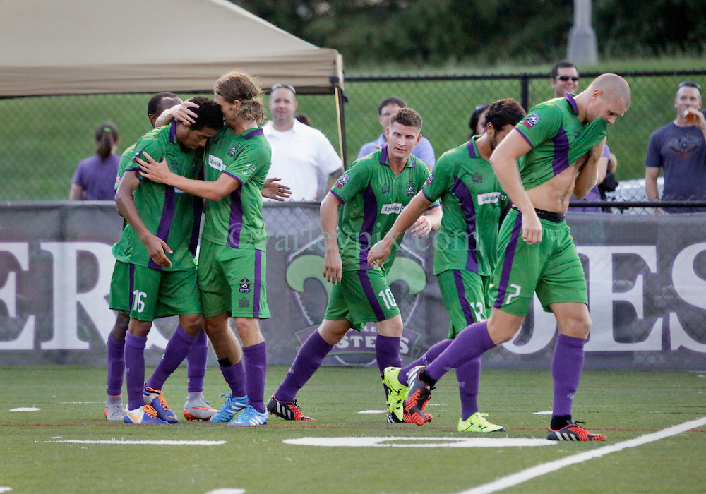 27 June 2015. New Orleans, Louisiana.<br /> National Premier Soccer League. NPSL. <br /> Jesters 1- Georgia Revolution 5.<br /> Jesters score and celebrates their only goal as the New Orleans Jesters lose 1-5 to the Georgia Revolution in a lightning delayed game at home in the Pan American Stadium. <br /> Photo©; Charlie Varley/varleypix.com