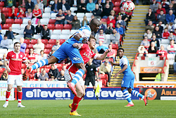 Peterborough United's Gabriel Zakuani beats Barnsley's Sam Winnall in the air - Photo mandatory by-line: Joe Dent/JMP - Mobile: 07966 386802 - 18/04/2015 - SPORT - Football - Barnsley - Oakwell - Barnsley v Peterborough United - Sky Bet League One