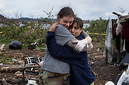 (Gabe Green | The Daily World)<br /> <br /> Shawna Baker, left, and Shirley Owens have a moment of affection Thursday while cleaning up camp.