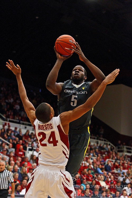 Feb 19, 2012; Stanford CA, USA; Oregon Ducks forward Olu Ashaolu (5) shoots over Stanford Cardinal forward Josh Huestis (24) during the second half at Maples Pavilion. Oregon defeated Stanford 68-64. Mandatory Credit: Jason O. Watson-US PRESSWIRE