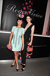 Left to right, BIP LING and TALI LENNOX at a party hosted by Ines de la Frassange and Bruno Frisoni for Roger Vivier to launch the Roger Vivier book held at The Saatchi Gallery, London on 24th April 2013.
