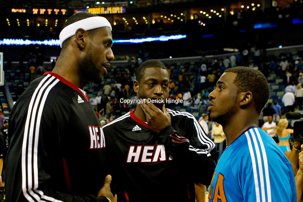October 13, 2010; New Orleans, LA, USA; New Orleans Hornets point guard Chris Paul (3) meets with Miami Heat small forward LeBron James (6) and shooting guard Dwyane Wade (3) following a preseason game at the New Orleans Arena. The Hornets defeated the Heat 90-76. Mandatory Credit: Derick E. Hingle