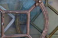 A collage of old metal window frames in France forms an interesting metallic and glass pattern.