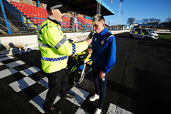 Fife Division, Roads Policing Festive launch, Central Park, Cowdenbeath, 29-11-2019<br /> <br /> Cowdenbeath player Connor Smith does a breath test from PC Seb Milne<br /> <br /> (c) David Wardle | Edinburgh Elite media