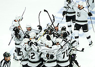 The Kings' celebrate after Alec Martinez's game-winning overtime goal against the Chicago Blackhawks to give Los Angeles a 5-4 victory in Game 7 of the Western Conference Final of the 2014 NHL Stanley Cup Playoffs at the United Center in Chicago Sunday night.