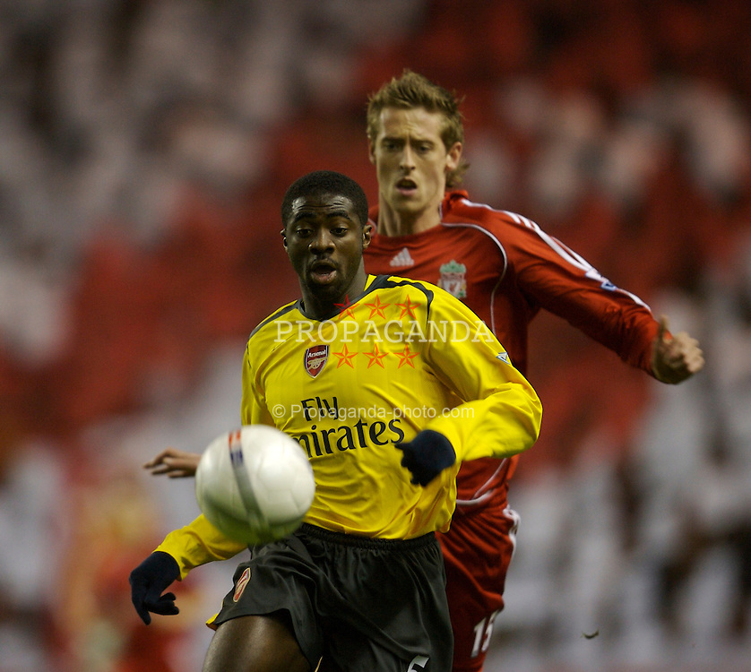 Liverpool, England - Saturday, January 6, 2007: Arsenal's Kolo Toure and Liverpool's Peter Crouch during the FA Cup 3rd Round match at Anfield. (Pic by David Rawcliffe/Propaganda)