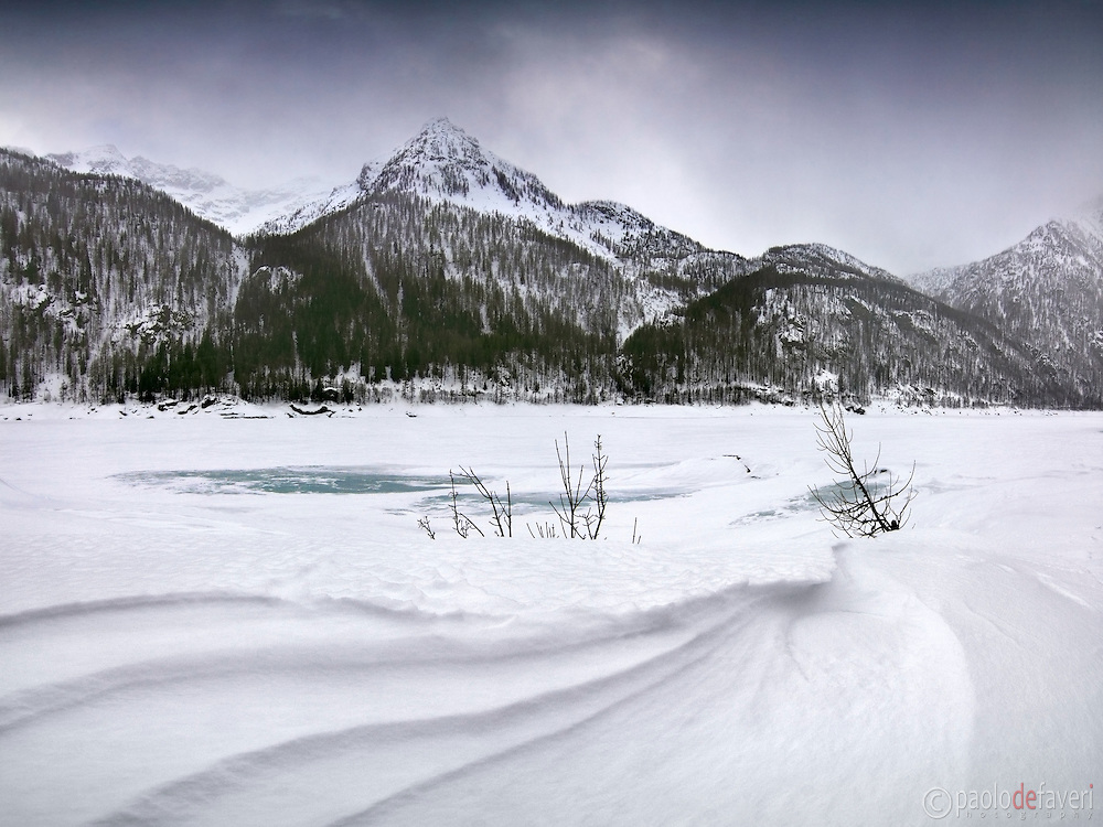 -15°C and wind blowing at 60 kph are not  what one would call as confortable conditions, but it's certainly the kind of weather for some good, dramatic winterscape. Taken at the lake of Ceresole Reale in the Gran Paradiso National Park, Italy