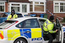 © Licensed to London News Pictures . 17/01/2015 . Stockport , UK . Police guard 28 Meadway Road , Cheadle Hulme , Stockport this afternoon (Saturday 17th January 2015 ) after a man and a woman in their 40s were found dead inside last night (16th January 2015) . Photo credit : Joel Goodman/LNP