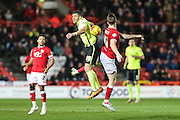 Brighton striker, Tomer Hemed (10) and Bristol City defender, Alex Pearce (16) battle for the ball during the Sky Bet Championship match between Bristol City and Brighton and Hove Albion at Ashton Gate, Bristol, England on 23 February 2016. Photo by Shane Healey.