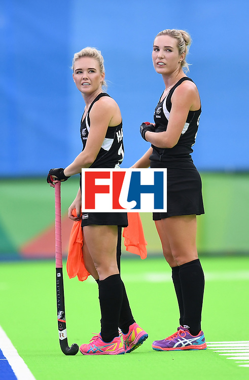 New Zealand's Charlotte Harrison (L) and New Zealand's Sophie Cocks look on during the women's field hockey Spain vs New Zealand match of the Rio 2016 Olympics Games at the Olympic Hockey Centre in Rio de Janeiro on August, 10 2016. / AFP / MANAN VATSYAYANA        (Photo credit should read MANAN VATSYAYANA/AFP/Getty Images)