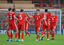 WREXHAM, WALES - Friday, September 6, 2019: Wales' captain Regan Poole (L) and Wales' Robbie Burton celebrate at the final whistle during the UEFA Under-21 Championship Italy 2019 Qualifying Group 9 match between Wales and Belgium at the Racecourse Ground. Wales won 1-0. (Pic by Laura Malkin/Propaganda)
