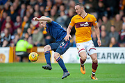 Steven Naismith (#14) of Heart of Midlothian wins the ball from Tom Aldred (#5) of Motherwell FC during the Ladbrokes Scottish Premiership match between Motherwell and Heart of Midlothian at Fir Park, Motherwell, Scotland on 15 September 2018.