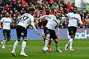 Richard Keogh (6) of Derby County holds off Famara Diedhiou (9) of Bristol City during the EFL Sky Bet Championship match between Bristol City and Derby County at Ashton Gate, Bristol, England on 27 April 2019.