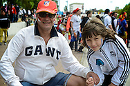 General view of the exterior of the stadium showing an Atletico Madrid fan with his Real Madrid supporting son pictured ahead of the UEFA Champions League Final at Estádio da Luz, Lisbon<br /> Picture by Ian Wadkins/Focus Images Ltd +44 7877 568959<br /> 24/05/2014