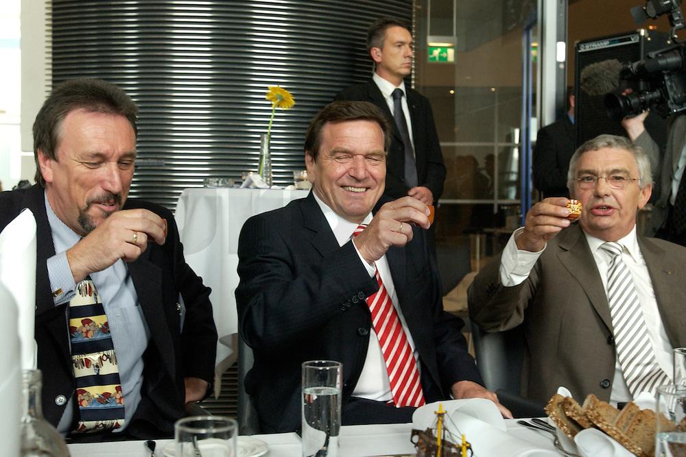 27 APR 2004, BERLIN/GERMANY:<br /> Gerhard Schroeder (M), SPD, Bundeskanzler, Reiner Alberts (L), Regional-Marketing Norderfleisch, Jann-Peter Janssen (R), MdB, SPD, aus dem ostfriesischen Wahlkreis Aurich-Emden, haben einen Schnaps Marke &quot;Grootheider Bittern&quot; getrunken, waehrend dem Eroeffnungsabend der 1. kulinarischen Ostfriesland-Woche, Abgeordneten-Restaurant des Deutschen Bundestages, Rechstagsgebaeude<br /> IMAGE: 20040427-04-015<br /> KEYWORDS: Gerhard Schr&ouml;der, Regional-Marketing Norderfleisch, Parlamentarischer Abend, Alkohol, Getr&auml;nk, Getraenk