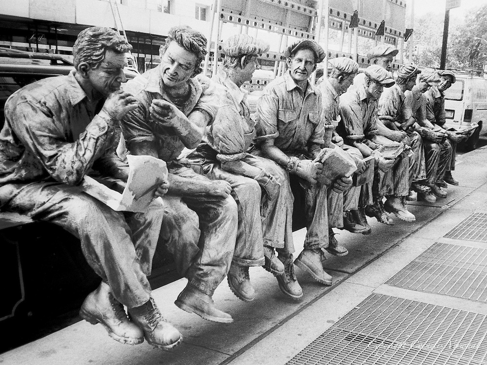 """Sculpture by Sergio Furnari based on the 1932 photograph """"Lunch Atop a Skyscraper"""";, by Charles C Ebbets; Avenue of the America's, New York, 2007..."""