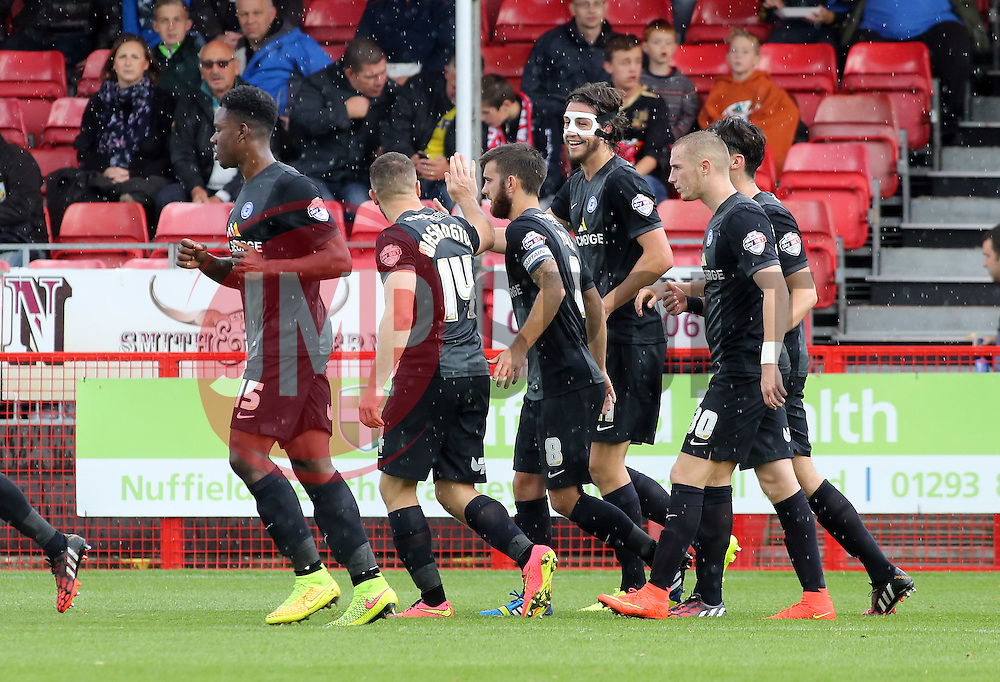 Peterborough United's Christian Burgess (masked) celebrates after claiming to score the second goal, later awarded to Conor Washington - Photo mandatory by-line: Joe Dent/JMP - Mobile: 07966 386802 - 11/10/2014 - SPORT - Football - Crawley - Checkatrade.com Stadium - Crawley Town v Peterborough United - Sky Bet League One