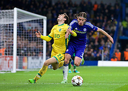LONDON, ENGLAND - Wednesday, December 10, 2014: Chelsea's Filipe Luis clashes with Sporting Clube de Portugal's Paulo Oliveira during the final UEFA Champions League Group G match at Stamford Bridge. (Pic by David Rawcliffe/Propaganda)