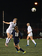 CB East's Megan Mannato #26 heads the ball as Cedar Cliff's Rachael Reilly #15 defends in the first half Tuesday November 10, 2015 in Doylestown, Pennsylvania.  (Photo by William Thomas Cain)