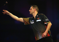 Toni Alcinas throws during his match with Craig Ross during day three of the William Hill World Darts Championships at Alexandra Palace, London.