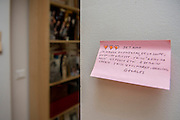 "March 6, 2015, Paris, France. Post-it notes decorate the Paris' apartment where Georges and Maryse Wolinski used to live. French Cartoonist Georges Wolinski (1934 –2015) wrote daily post-it notes to his wife Maryse Wolinski (1943, Algiers). Two month after the death of Georges Wolinski, the apartment is full of souvenirs and notes, attesting a half-century-long love relation: ""I love you, I've eaten foie gras, soup, some cake, I read in ""Adieu ma Jolie"". I think of you, until tomorrow darling. I kiss you, Maryse, darling. Georges."" <br /> The cartoonist Georges Wolinski was 80 years old when he was murdered by the French jihadists Chérif en Saïd Kouachi, he was one of the 12 victim<br /> s of the massacre in the Charlie Hebdo offices on January 7, 2015 in Paris. Charlie Hebdo published caricatures of Mohammed, considered blasphemous by some Muslims. During his life, Georges Wolinski defended freedom, secularism and humour and was one of the major political cartoonists in France. The couple was married and had lived for 47 years together. Photo: Steven Wassenaar."